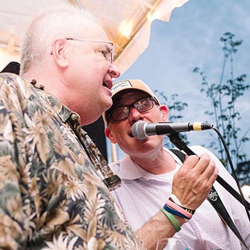 A musical performance at Reinhart Guest House's annual Rockin' on the Avenue fundraiser